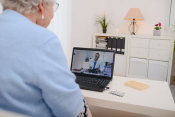 OrthoConnecticut patient participating in telemedicine appointment